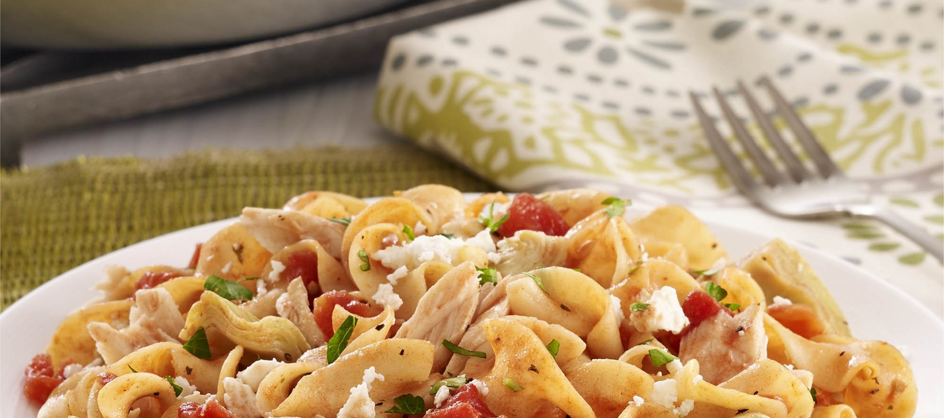 Egg noodles with tuna, artichokes, diced tomatoes, and feta cheese