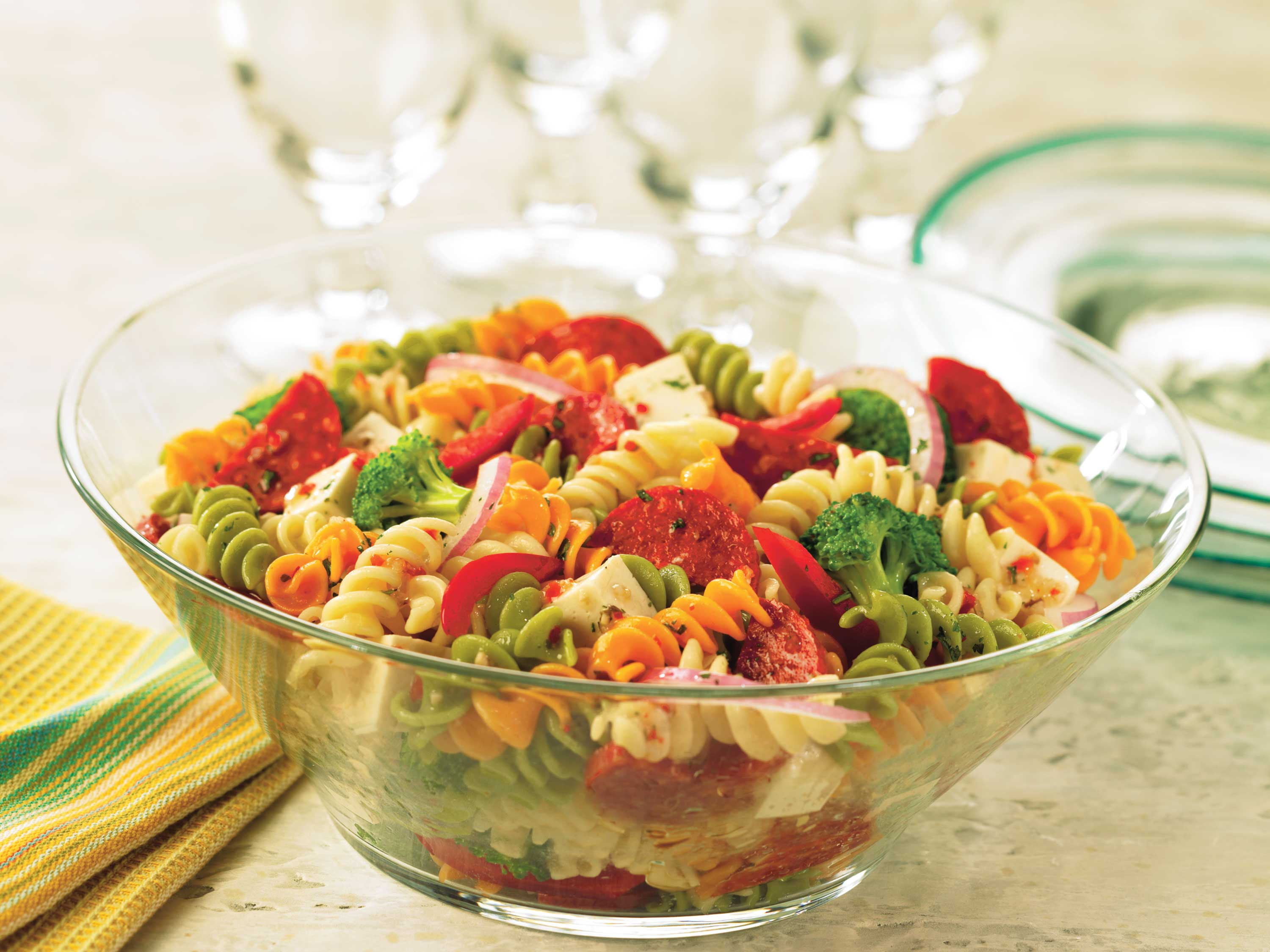 Pepperoni, mozzarella, and vegetables combine for an Italian-inspired pasta salad that's easy and quick to pull together.